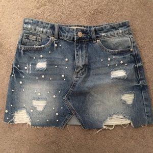 Acid wash jean skirt.